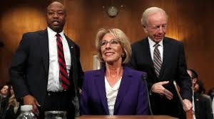 betsy-devos-with-senators-scott-and-lieberman